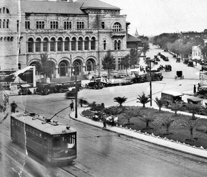 An historic panorama of the Alamo Plaza, October 26, 1918. View looking northeast with Post Office and Federal Building (upper left), streetcar (lower left) and Alamo Long Barrack wall (far right). Photo courtesy of UTSA Libraries, Special Collections.
