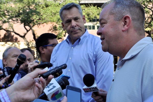 NCAA Committee member Mark Hollis (right) and Committee Chair Scott Barnes answer questions from media. Photo by Iris Dimmick.