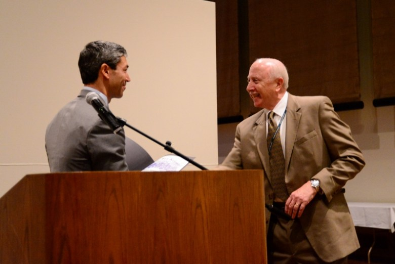 Ron Nirenburg congratulates William J. Chiego at Tuesday's luncheon. Photo by Page Graham.
