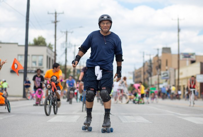 A man rides down Broadway on old fashioned roller skates at the 7th ?iclovia. Photo by Scott Ball.