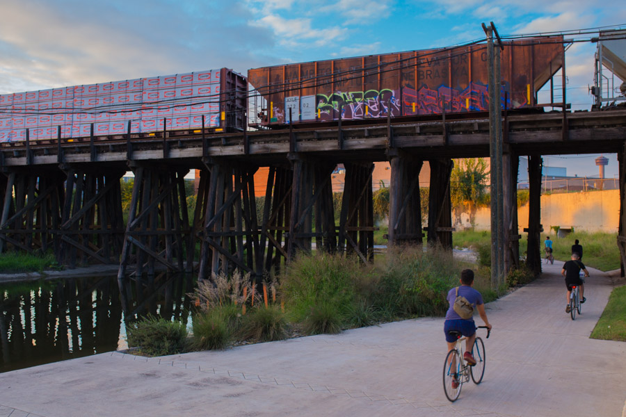 Cyclists ride north right before sunset on the Mission Trail. Photo by Scott Ball.