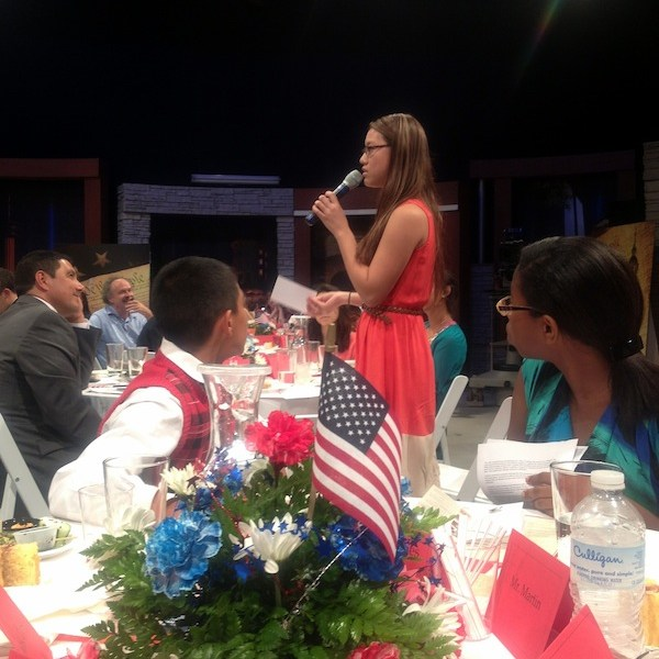 A student gives her response to the evening's question as East Central ISD Superintendent Roland Toscano (left) looks on. Photo by Lily Casura.
