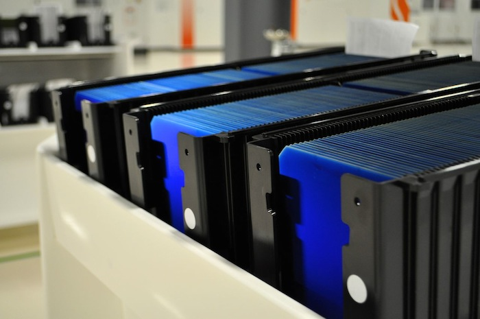 """N-type solar wafers get their blue glow after the """"doping"""" process. Mission Solar Energy manufacturing plant. Photo by Iris Dimmick."""