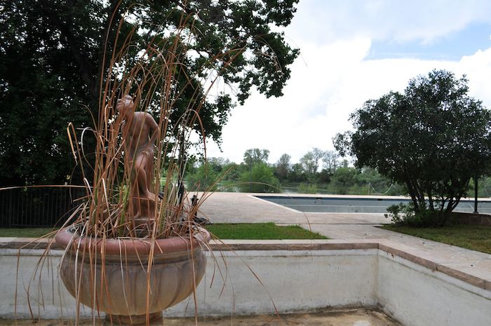 An over-drown fountain and empty pool on the Red Berry Estate. Photo by Iris Dimmick.