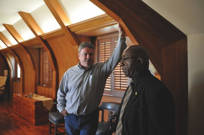 Timothy Cone of NRP Group and District 2 Councilmember Keith Toney discuss the future of the Red Berry Estate while touring the mansion. Photo by Iris Dimmick.