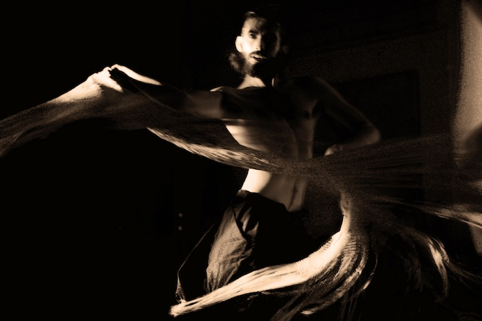 """Stephan Gaeth performing in """"Angel of Gravity."""" Photo © Nicole Marie Moore."""
