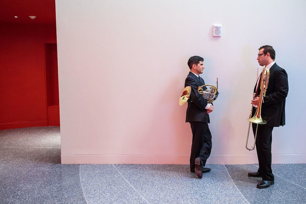 Two San Antonio Symphony musicians talk before the opening ceremony at the Tobin Center. Photo by Scott Ball.