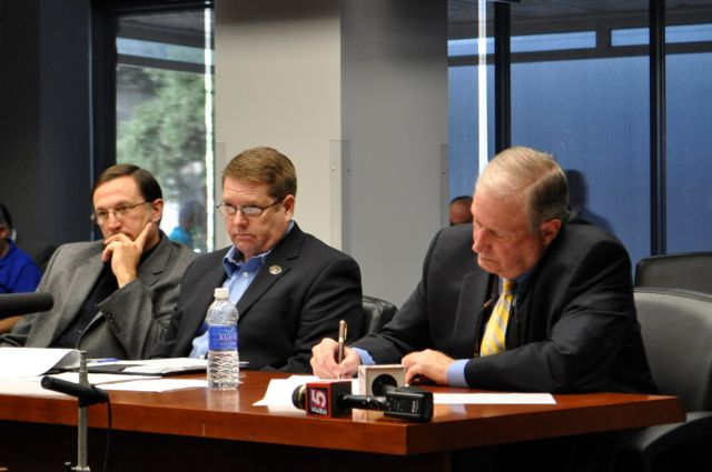 From left: Police union health care expert Randy McGraw, SAPOA President Mike Helle, and attorney Ron DeLord listen to the City's outline of its health care counter offer. Photo by Iris Dimmick.