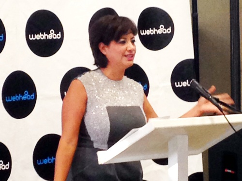 Janie M. Gonzalez, president and CEO of Webhead, speaks to the crowd at Peer 1 Hosting. Photo by Jeanette Fernandez