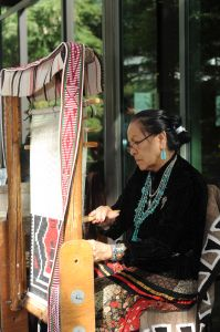 Nanabah Aragon, expert Navajo weaver and declared Living Treasure by the state of Arizona at the Briscoe Museum's Grand Opening. She will join us once again at the Yanaguana Indian Arts Market. Photo by Greg Harrison.