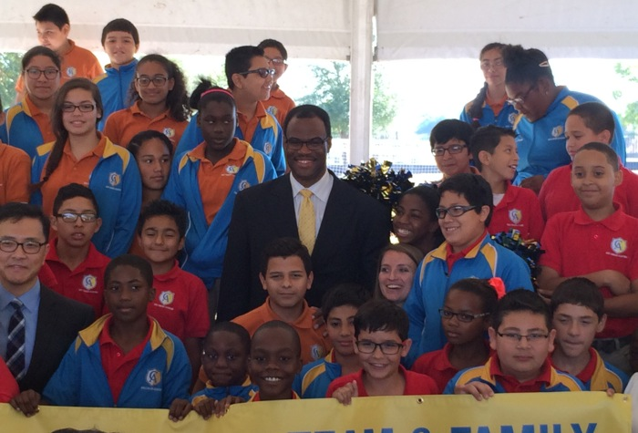 David Robinson, founder of the Carver Academy on San Antonio's Eastside, stands with excited students during the groundbreaking of the new College Preparatory School. Photo by Katherine Nickas.