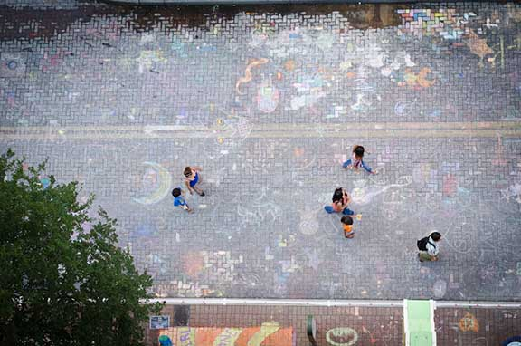 Houston Street filled with chalk post-Chalk It Up. Photo by Francisco Cortes.