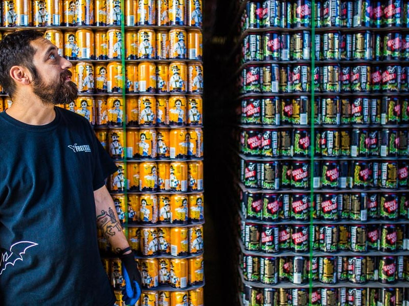 Brewery Distribution manager Jesse Campos takes a look at the stacks of beer ready to be shipped at Freetail Brewing Co. on South Presa Street. Photo by Scott Ball