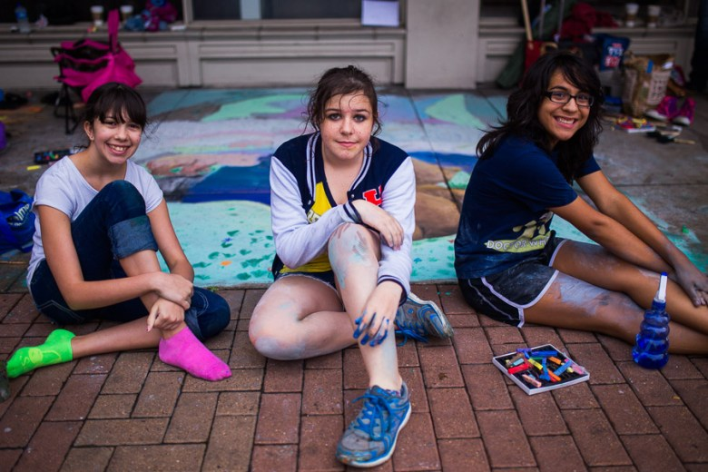 """Artists of """"Beartopia"""" Madilyn, Rin, and Kioko from Bradley Middle School at Artpace's 2014 Chalk It Up. Photo by Scott Ball."""