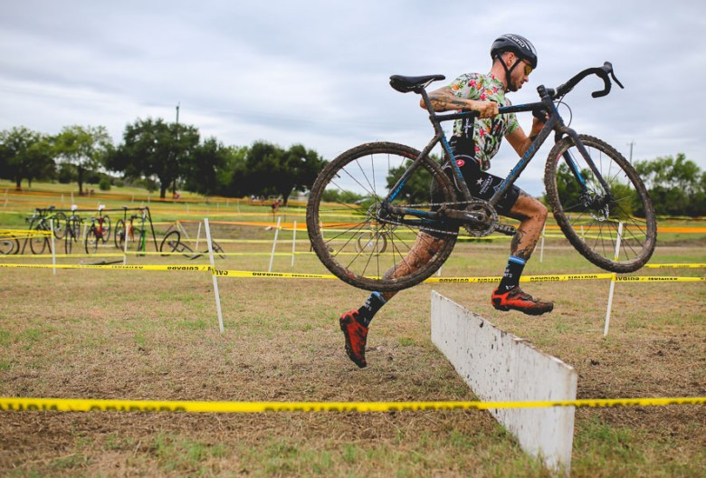Jumping over wooden barricades is a classic CX maneuver. Photo by Scott Ball.