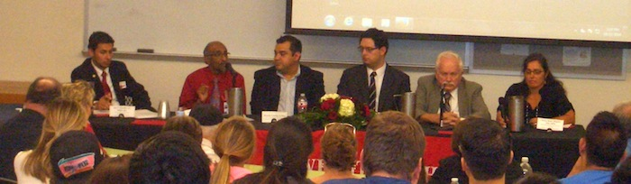Panelists fill the dais at the Ebola community conversation held at UIW on Wednesday. From left: Jose Martinez, Jr., UIW director of international student and scholar services, Dr. Anil T. Mangla,Ricardo Carrion, Jr., Dr. Jose Cadena, Dr. John R. Graybill, and Cherise Rohr-Allegrini. Photo by Lily Casura.