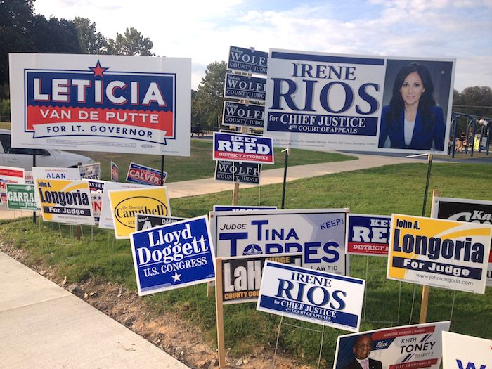 Lion's Field covered in candidate signs. Photo by Robert Rivard.