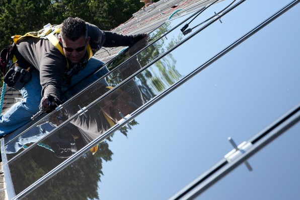 A local installer adjusts panels on a San Antonian rooftop. Photo courtesy of CPS Energy.