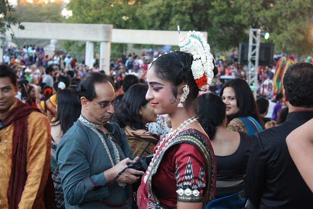 A young woman smiles among a crowd of 15,000 during the 2013 Diwali San Antonio festival. Photo by Kay Richter.