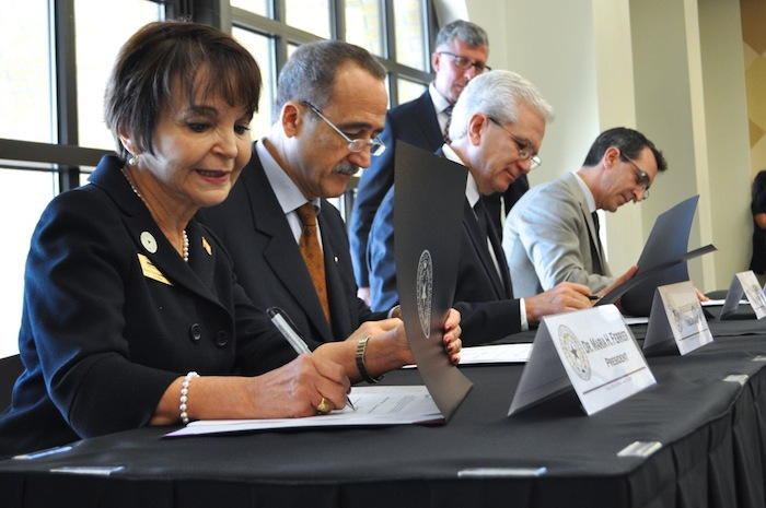 From left: A&M-SA President Maria Hernandez Ferrier, Ambassador Enric Panés, Consul Raul B. Rodriguez, and Instituto Cervantes' Anastasio Sanchez Zamorano sign the memorandum of understanding. Photo by Iris Dimmick.