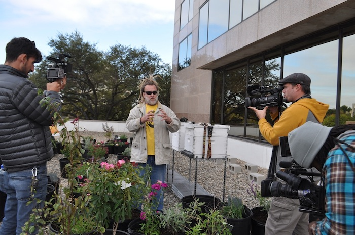 Walter Schumacher of the Central Texas Bee Rescue program talked to reporters on the roof of the Omni San Antonio Hotel at the Colonnade. Photo by Iris Dimmick.