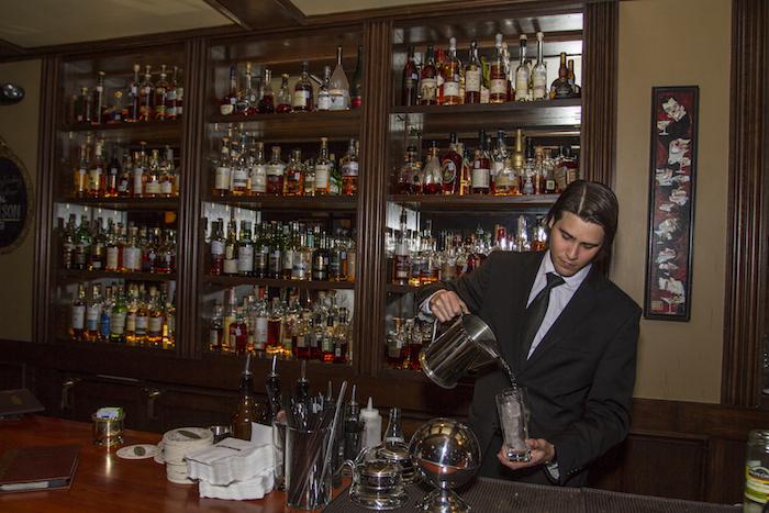 Bartender Jordan Corney prepares a cocktail at Bohanan's, 222 E. Houston. Photo by Steven Starnes.