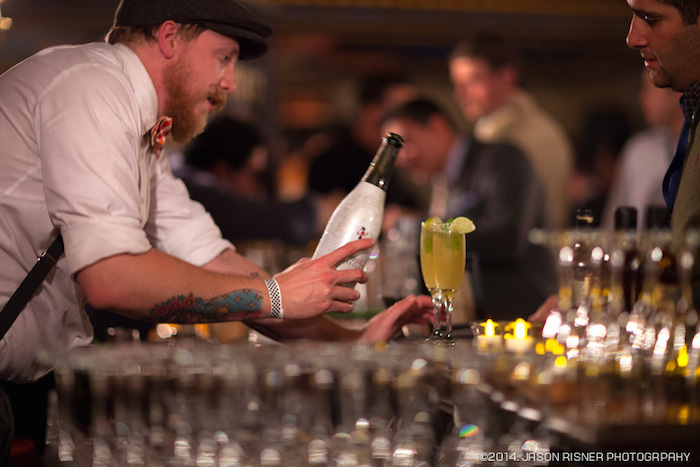 A bartender serves guests craft cocktails during the 2014 SA Cocktail Conference. Photo courtesy of Jason Risner Photography / San Antonio Cocktail Conference.