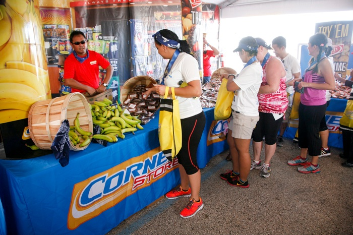 Runners stock up on Corner Store's selection of treats after the race in Houston. Photo by John Everett.