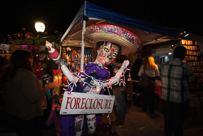 Día de los Muertos revelers take over La Villita to enjoy a market, altar contest, and concerts. Photo by Stephen G. McDowell.