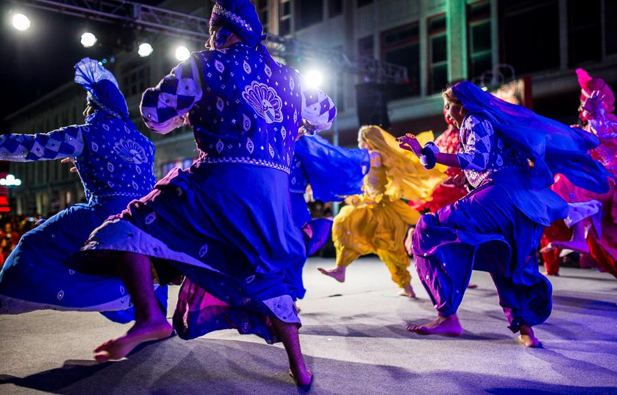 Dancers stomp their feet in an energetic dance at the 6th annual Diwali San Antonio. Photo by Scott Ball.