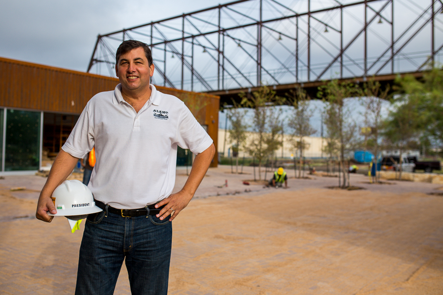 Alamo Beer President Eugene Simor poses for a photo in front of the popular Hays Bridge and construction of the Alamo Beer Company brewery. Photo by Scott Ball.