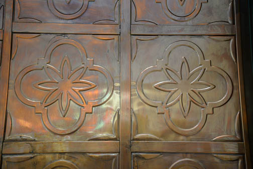 A close-up of the copper doors at the Patriots' Casa. They are a symbol of students entering a bright new future. Photo by Annette Crawford.