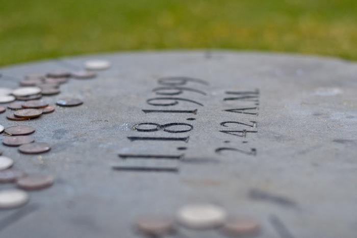 In the center of the Spirit Ring lies a marker for the Bonfire's center pole with the date and time of the Bonfire collapse in 1999. Photo by Alex Richter.