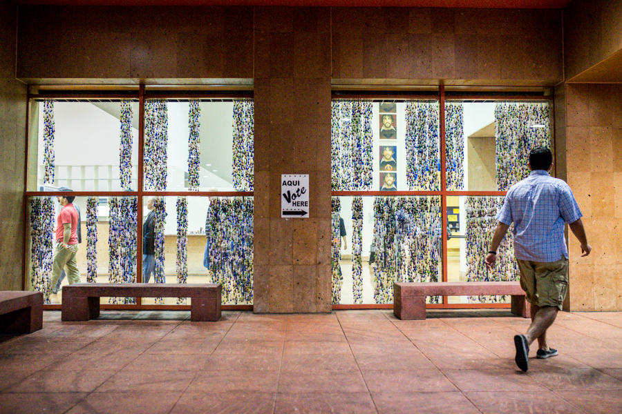 A voter walks into the Central Library polling location with less than an hour to spare. Photo by Scott Ball.