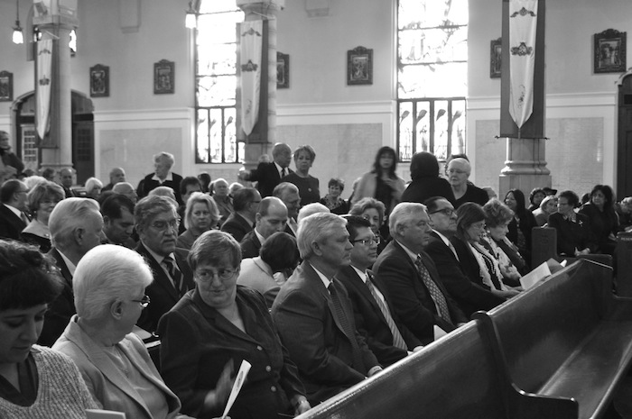 Friends and family of Elvira Munguia Cisneros (1924 - 2014), attend her Catholic funeral Mass at the Basilica of the National Shrine of the Little Flower. Photo by Iris Dimmick.