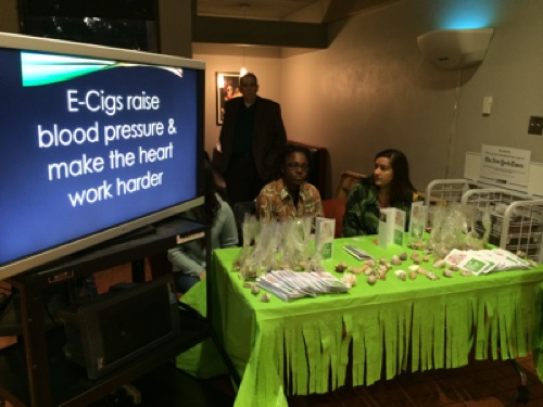 """First-year students in Trinity Biologist Robert Blystone's """"Knowing and Persuading"""" seminar hand out information on e-cigarettes. Photo by Katherine Nickas."""