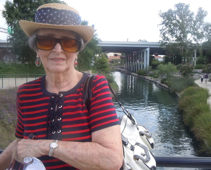"""Hilde """"Oma"""" Maeckle poses for a photo on the Museum Reach of the San Antonio River. Courtesy photo."""