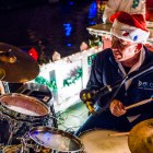 A drummer warms up before the Holiday River Parade begins. Photo by Scott Ball.