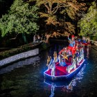 King Antonio Donald Miller waves to the crowd during the Holiday River Parade. Photo by Scott Ball.