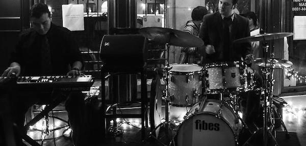 John Fernandez on drums and Chris Villanueva on piano at SoHo Wine and Martini Bar. Photo by Jennifer Lyde of Parish Photography.