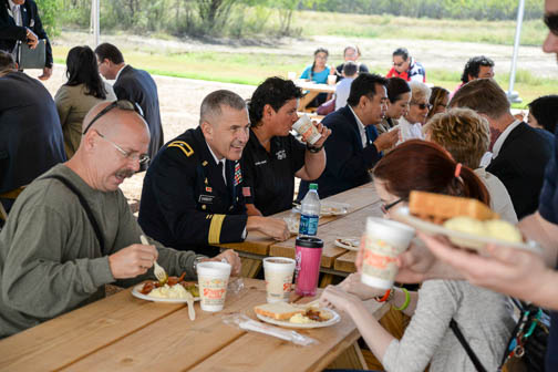 Guests enjoyed a free barbecue lunch after the ribbon-cutting ceremony for the Patriots' Casa. Photo by Annette Crawford.