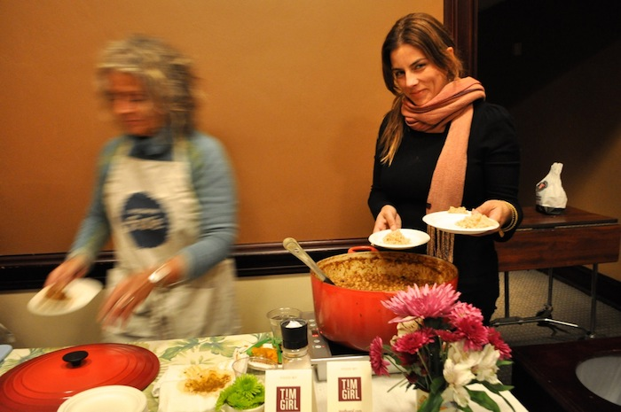 Tim McDiarmid (Tim the Girl catering) serves food at PeckaKucha San Antonio Vol. 16. Photo by Iris Dimmick.