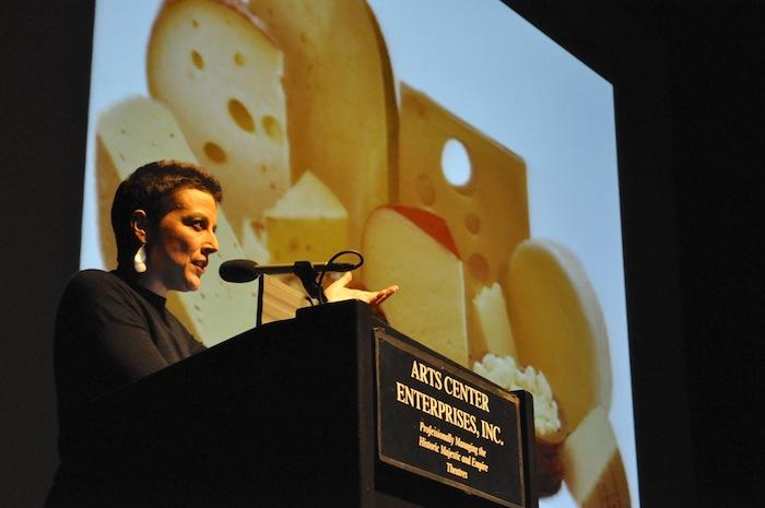 Molly Cox takes the stage at at PeckaKucha San Antonio Vol. 16. Photo by Iris Dimmick.