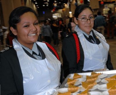 More than 4,000 people, including many youth, volunteer to work at the annual Raul Jimenez Thanksgiving Dinner held at the Henry B. Gonzalez Convention Center each Thanksgiving. Photo courtesy of Raul Jimenez Dinner website.