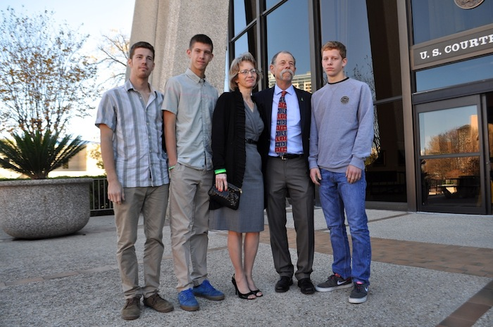Valerie and Mickey Redus (center) stand with their sons (from left) Everett, William, and Ethan outside the federal courthouse. Photo by Iris Dimmick.