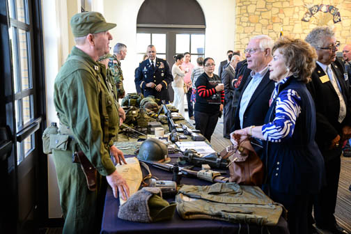Re-enactors from the Texas Military Forces Museum at Camp Mabry, Austin, talk to guests at the Patriots' Casa. Photo by Annette Crawford.