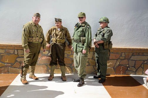 Re-enactors from the Texas Military Forces Museum at Camp Mabry, Austin, wait in line for a barbecue lunch. Photo by Annette Crawford.