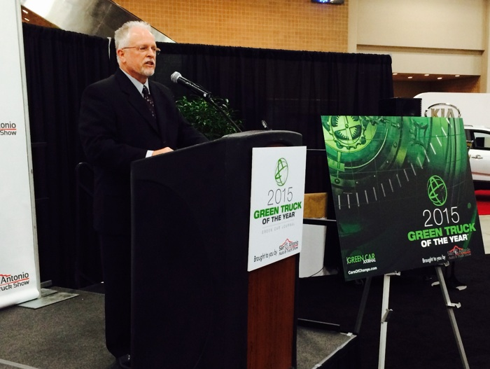 "Ron Cogan, editor and publisher of ""Green Car Journal,"" presents the winner of the 2015 Green Truck of the Year award. Photo by Katherine Nickas."