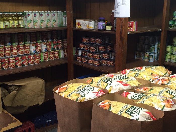 Donations from Inner City Development's Thanksgiving 365 program will provide for food pantry items for Westside families. Photo by Katherine Nickas.
