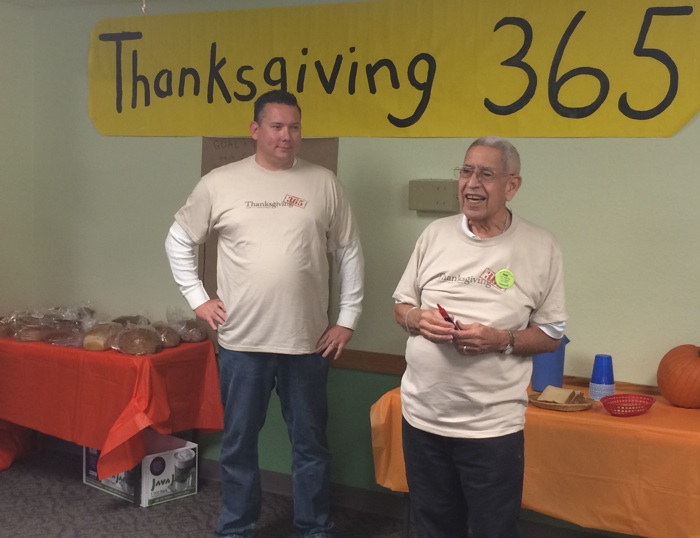 Ryan Haug and Bob Galvan announce this year's Thanksgiving 365 initiative at Inner City Development. Photo by Katherine Nickas.